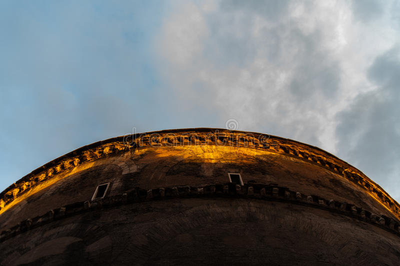 Side of pantheon from below at sunset with cloudy sky royalty free stock photos