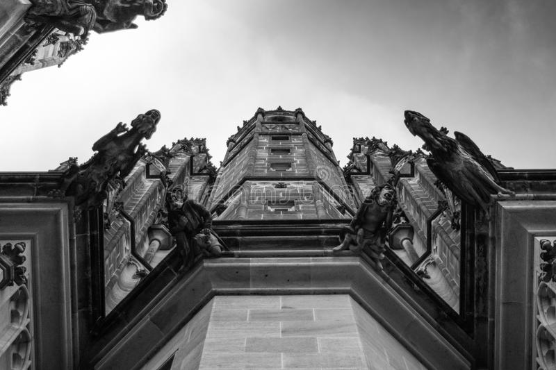 Side pillar of the Gothic Vysehrad cathedral in Prague with beautiful stone statues in black and white. Beautiful stone statues on the side of the Gothic royalty free stock images