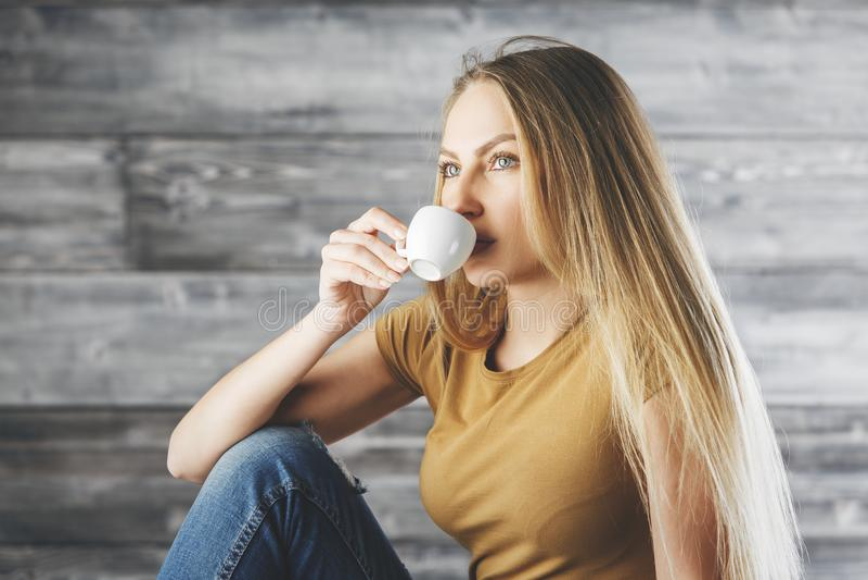 Thoughtful female drinking coffee stock image