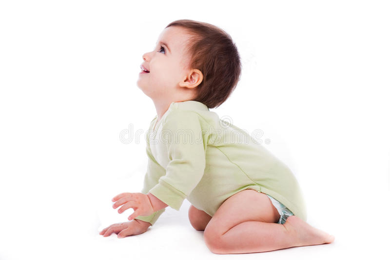 Side pose of baby sitting and looking up royalty free stock photography