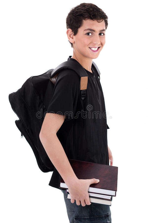 Side pose of handsome teenager boy student stock images