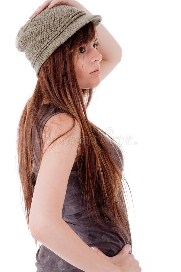 Side pose a model with a grey cap stock photos