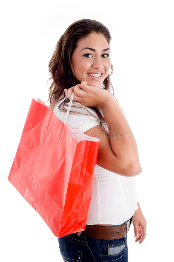 Side pose of woman holding bag royalty free stock images