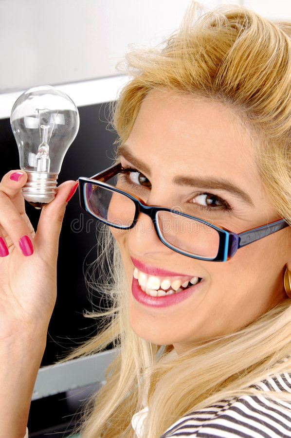 Download Side Pose Of Woman Holding Bulb Stock Image - Image: 7368497