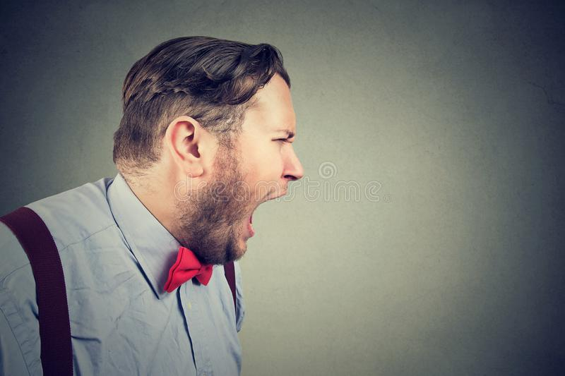 Portrait of a angry man screaming royalty free stock image