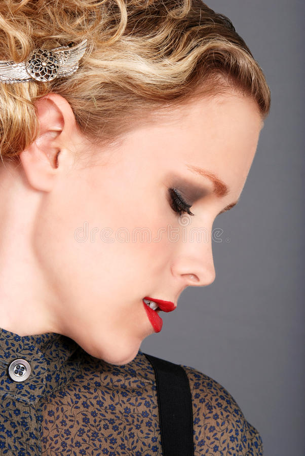 Side profile blonde woman royalty free stock images
