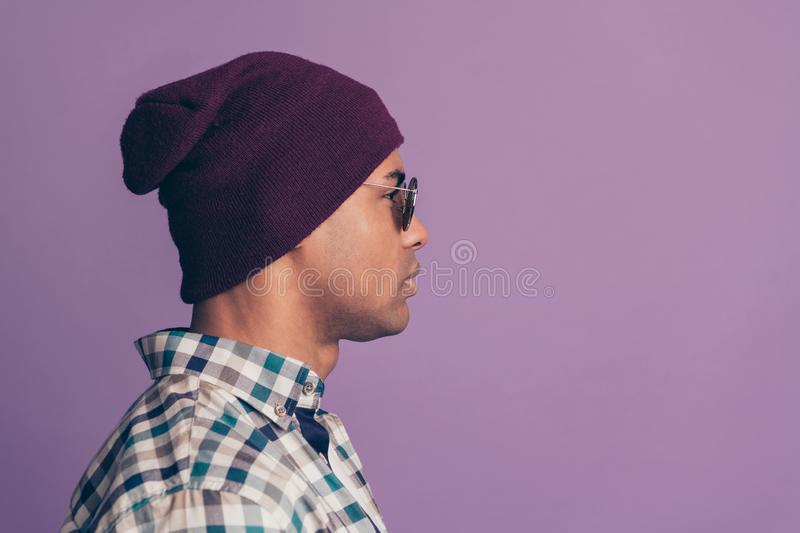 Side profile closeup photo portrait of serious confident handsome nice hipster guy id stylish violet cap isolated pastel stock images
