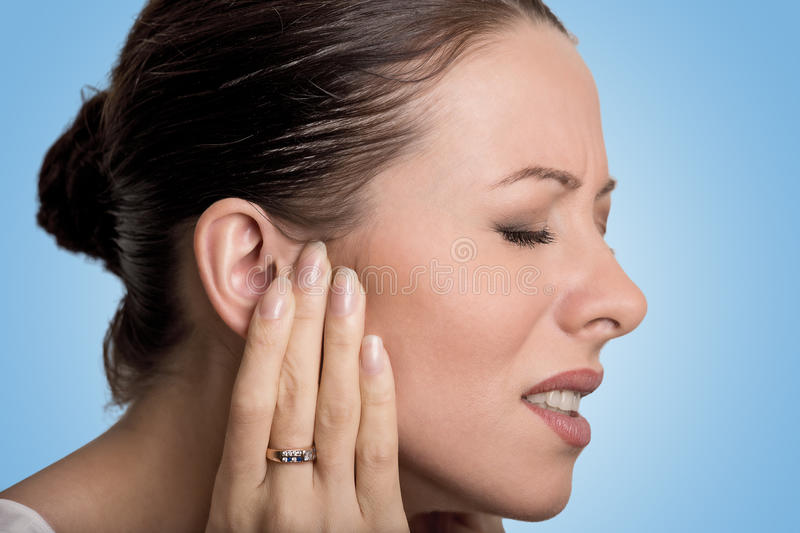 Side profile sick young female having ear pain stock photography