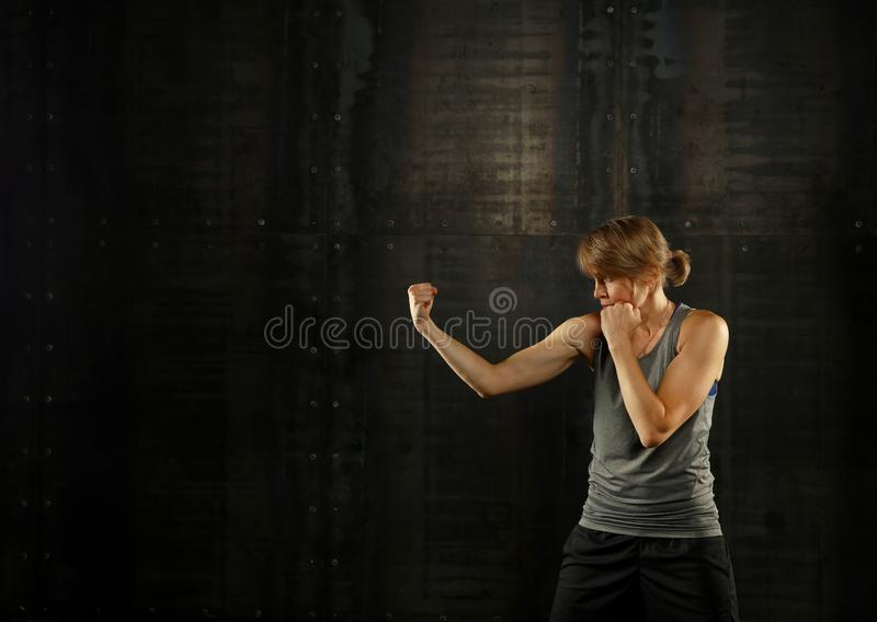 Side profile view of young athletic women boxing royalty free stock photography