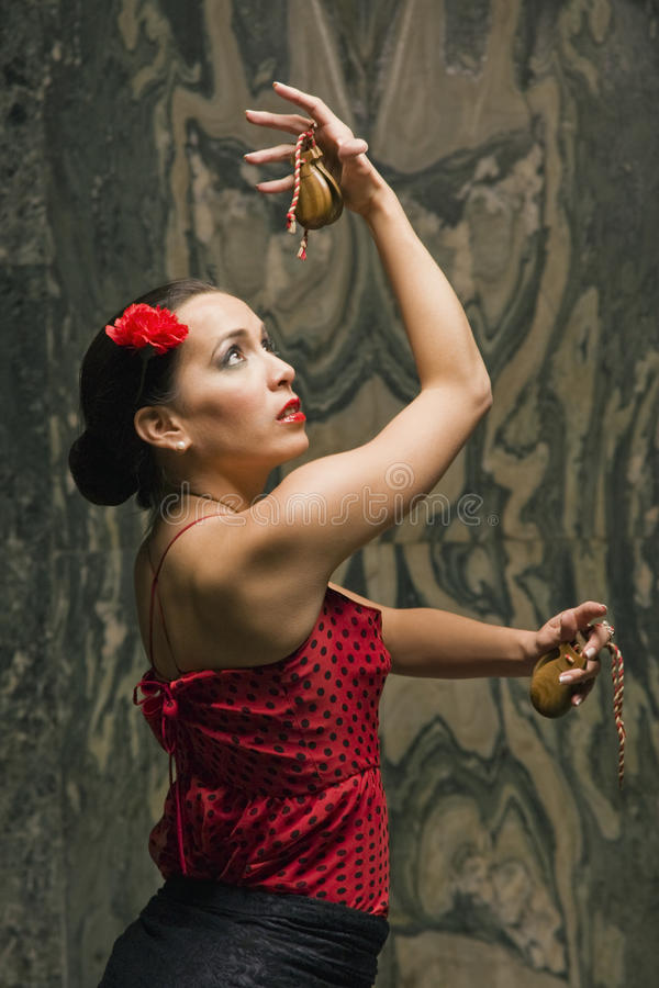 Side profile of a young woman dancing royalty free stock photography