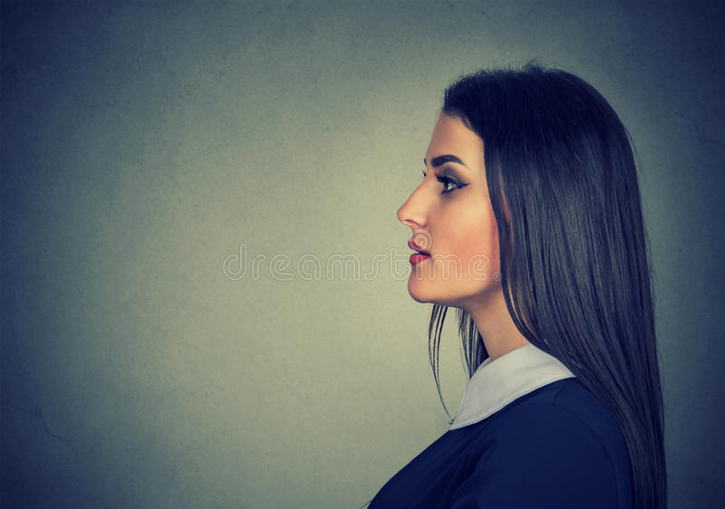 Side profile of a young woman royalty free stock images