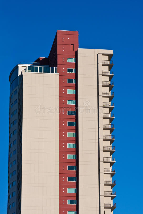 Download Side Of Red And Beige Condos On Blue Stock Photo - Image of city, windows: 14851620