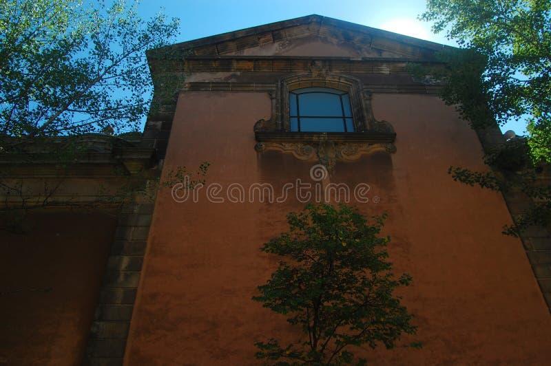 Side of rose-colored building in Parc de la Ciutadella, Barcelona. stock images