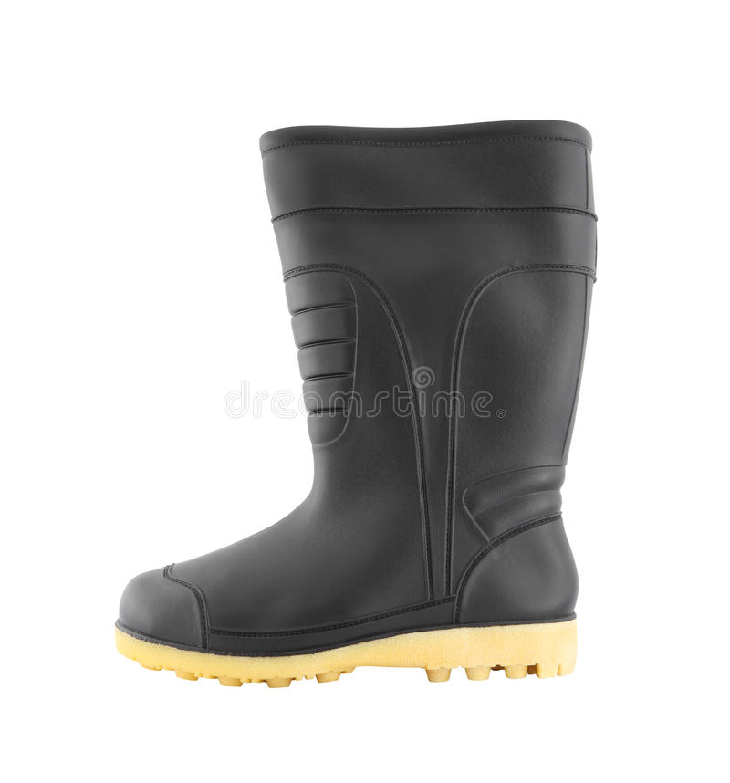 Side of rubber black boot shoe. On white background stock photos