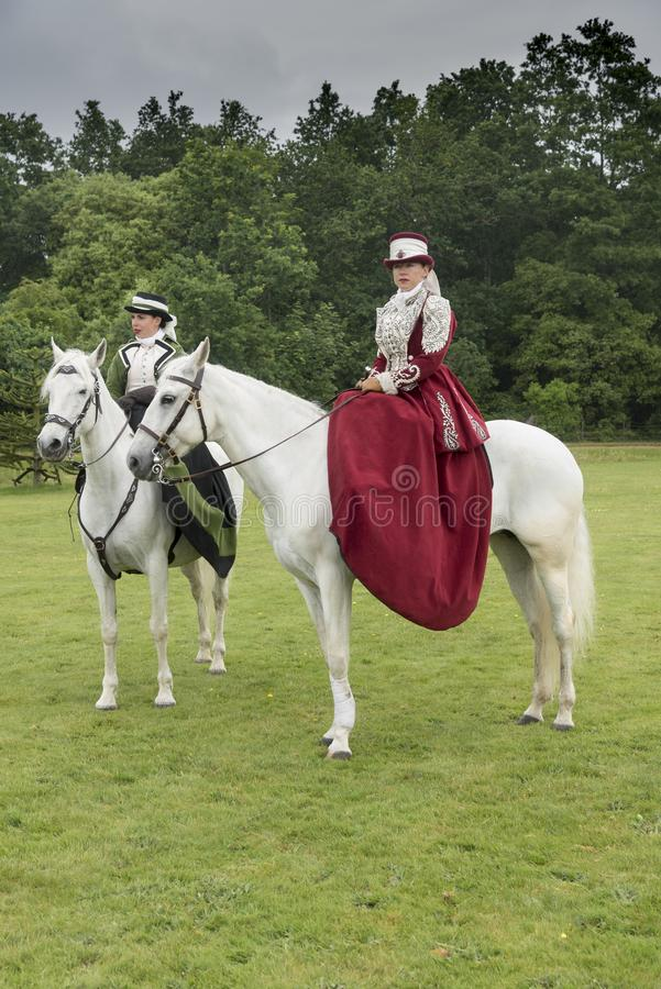 Side saddle riders at Victorias Garden party in Osborne House. E saddle riders at Victorias Garden party in Osborne House. Osborne House was built between 1845 stock image