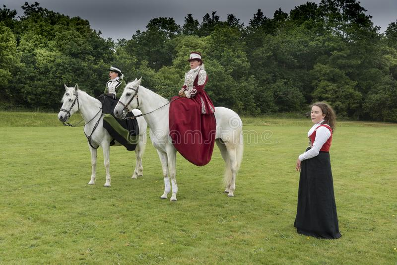 Side saddle riders at Victorias Garden party in Osborne House. NnOsborne House was built between 1845 and 1851 to provide Queen Victoria and Prince Albert with stock photography