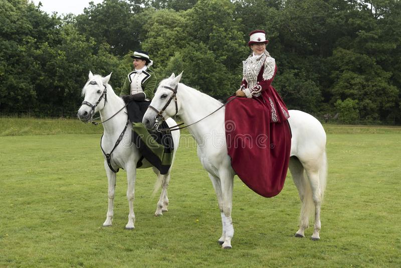 Side saddle riders at Victorias Garden party in Osborne House. Osborne House was built between 1845 and 1851 to provide Queen Victoria and Prince Albert with a stock photo