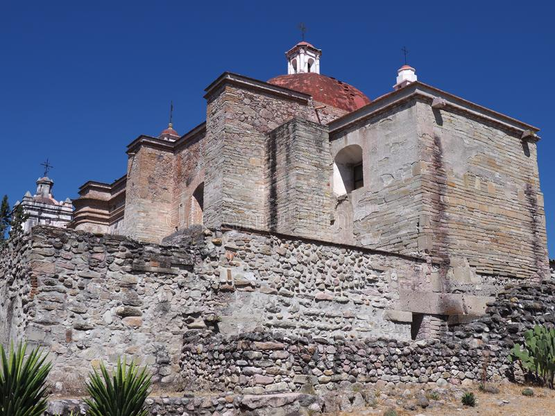 Side of San Pedro church in Mitla city at archeological site of Zapotec culture on Oaxaca landscape, Mexico. Side of San Pedro church in Mitla city at stock photos