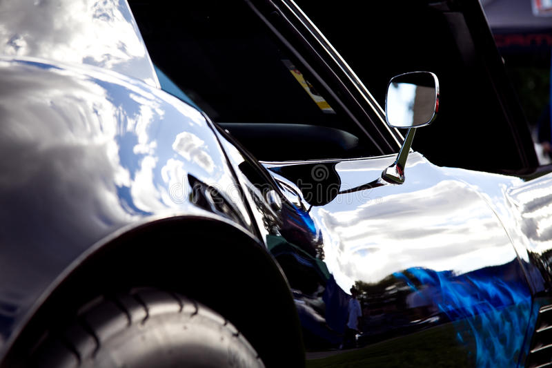 Side of a Shiny Black Corvette Stingray stock photography