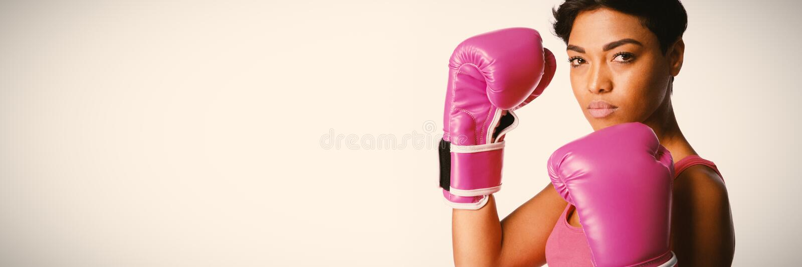 Side shot of woman fighting against breast cancer. Side shot of standing woman for breast cancer awareness on white background stock photography