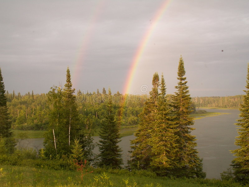 Side by side rainbows stock photos