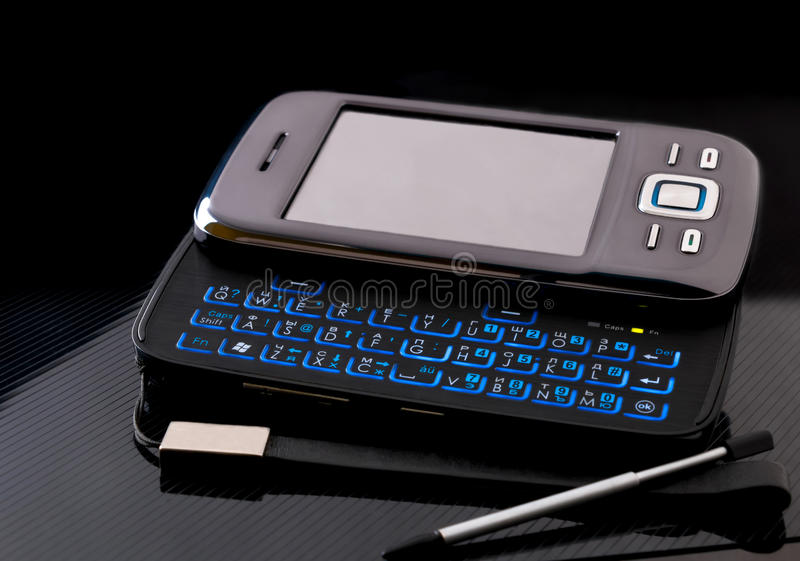 Side slider touchscreen smartphone with blank screen on black background stock image