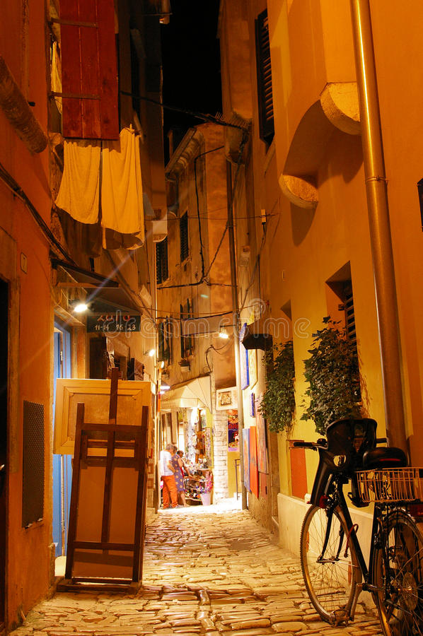 Narrow Side street in Rovinj Croatia. Quiet summer night on a side street in Rovinj, Croatia. Rovinj is a favorite tourist stop on the Istria coast stock photos