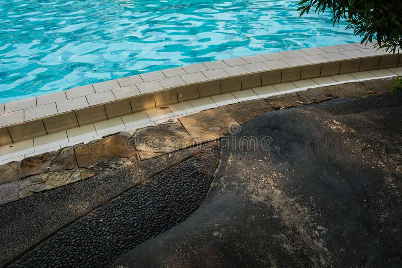 side of swimming pool stock photography