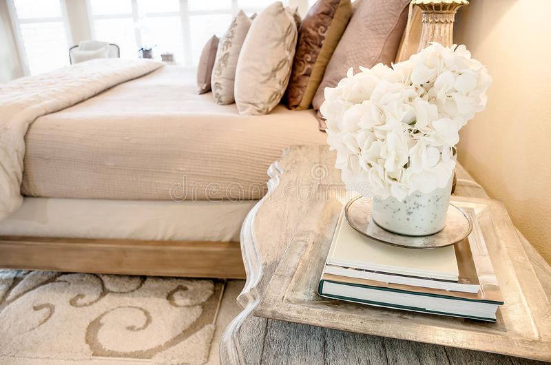 Side Table. In master bedroom suite. Great for home decor ideas and home staging stock images