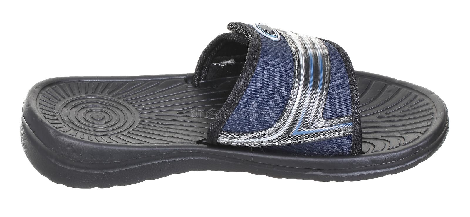 Side upper view of black rubber male beach sneaker. Slipper with white and blue velcro clasp, isolated on white royalty free stock image