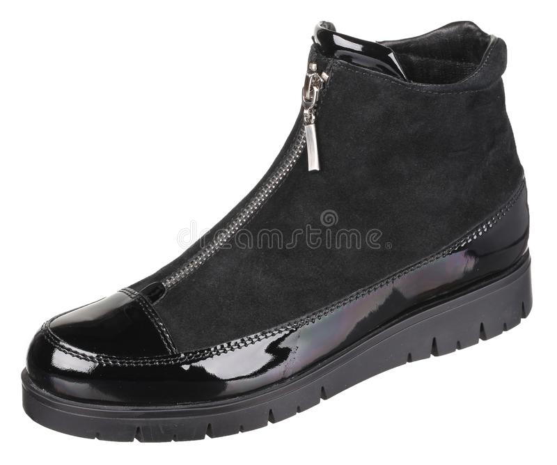 Side upper view of black suede and varnished leather female boot stock photo