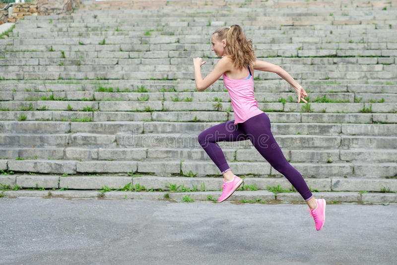 Side view of active sporty young running woman runner athlete with copy space concept sport health fitness loss weight stock images