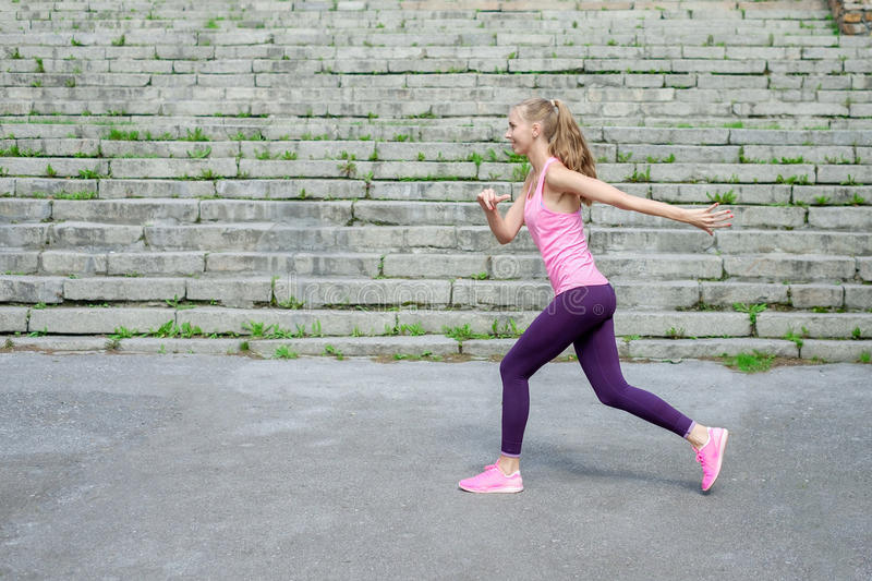 Side view of active sporty young running woman runner athlete with copy space concept sport health fitness loss weight stock image