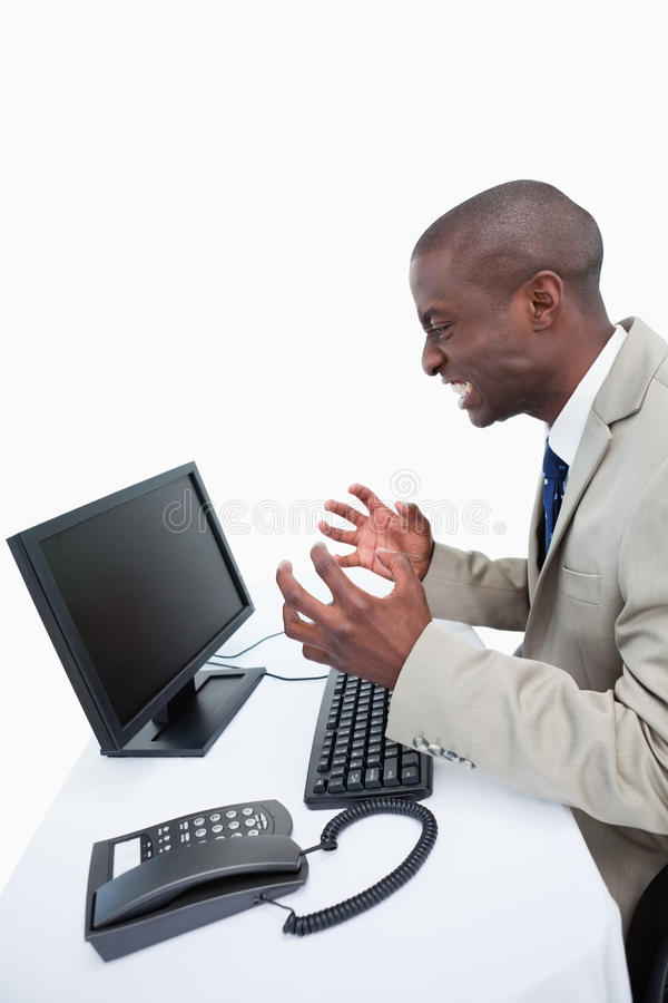 Download Side View Of An Angry Businessman Using A Monitor Stock Image - Image: 22693169