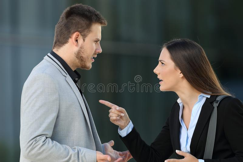 Couple of executives arguing on the street royalty free stock photography
