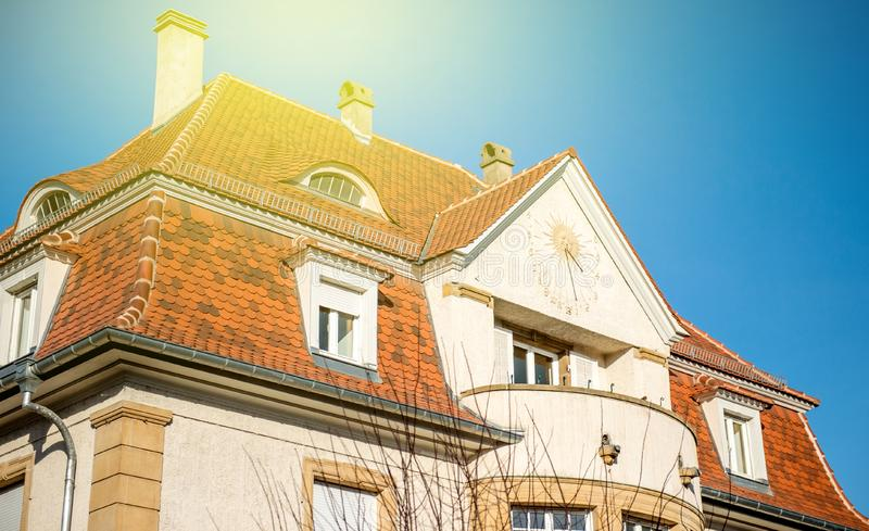 Side view of astronomical clock in on the facade of a house stock photography