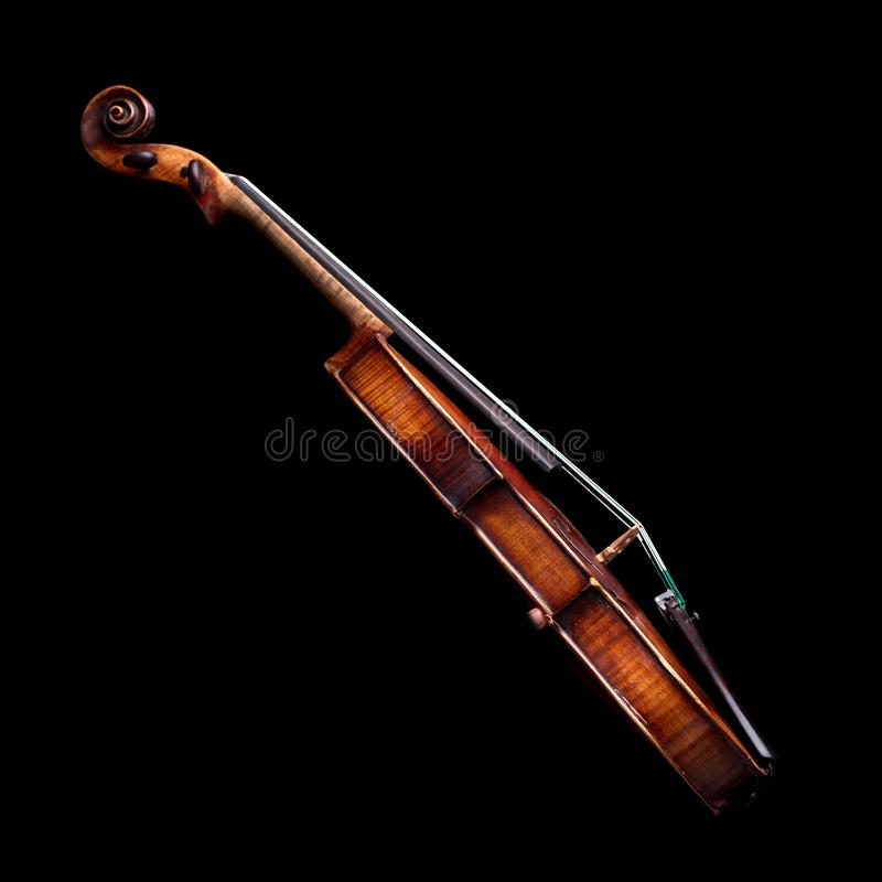 Side view of a baroque violin on black. Side view of a baroque violin isolated on black background royalty free stock photos