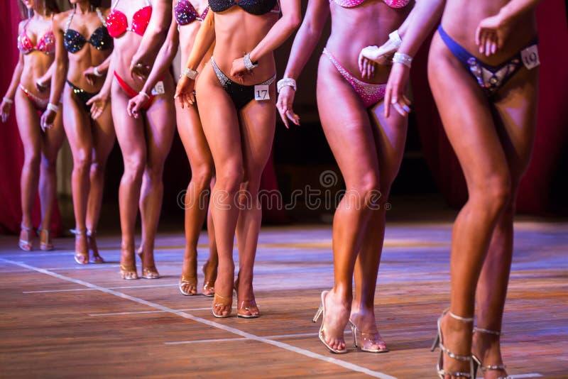 Side view of beautiful girls in bikini bottom to compete in a fitness bikini. Side view of beautiful girls in bikini bottom to compete in a fitness bikini royalty free stock image