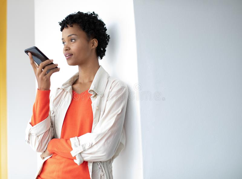 Young businesswoman talking on mobile phone in a modern office stock image