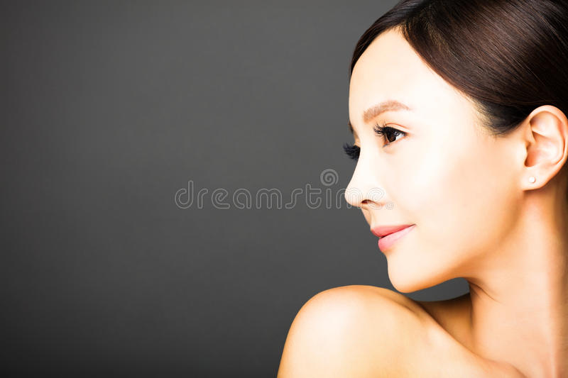 Side view beautiful young woman face royalty free stock photography