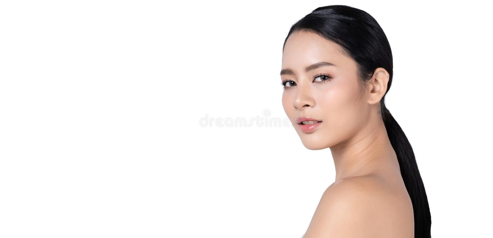 Side view of beauty Asian woman face closeup profile portrait looking at camera isolated on white background banner, Wide screen stock image