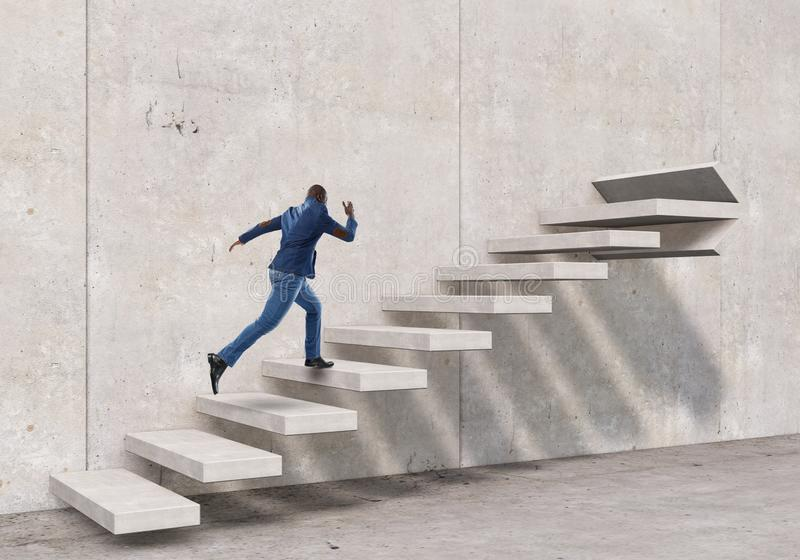Black businessman climbing stone stairs illustrating career development and success concept. Mixed media stock photo