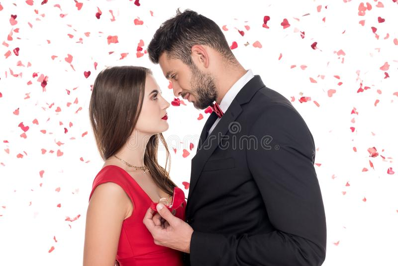Side view of boyfriend proposing girlfriend. Isolated on white, valentines day concept royalty free stock photos