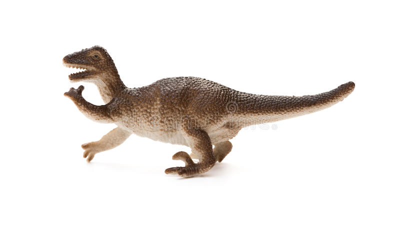 Side view brown plastic dinosaur toy on white background. Side view brown plastic dinosaur toy on a white background stock image