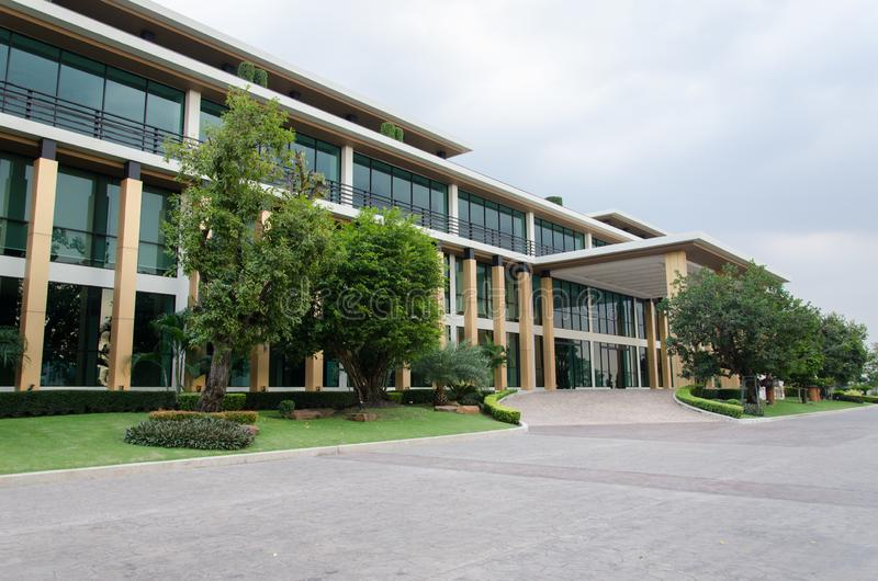 Side view of business building. On clear sky background stock image