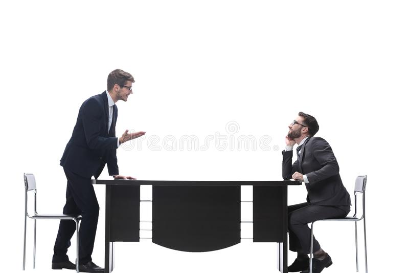Side view. business colleagues discussing something near the desktop stock photography