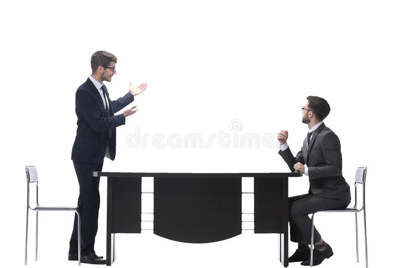 Side view. business colleagues discussing something near the desktop royalty free stock photo