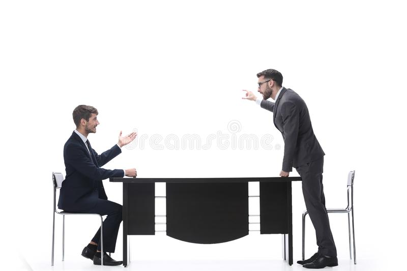 Side view. business colleagues discussing something near the desktop royalty free stock image