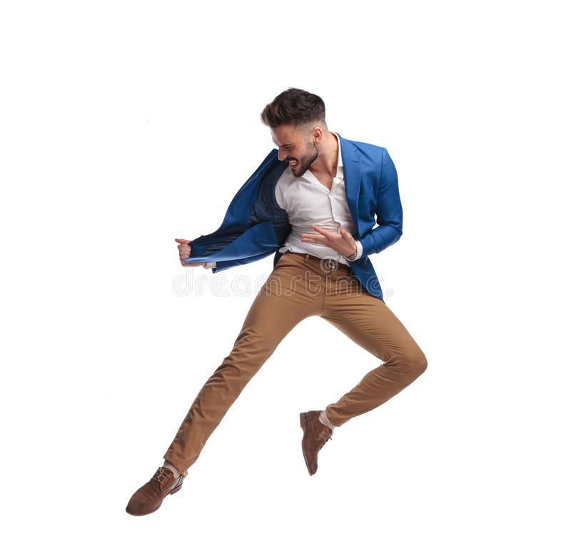 Side view of business man in suit jumping and screaming royalty free stock photo