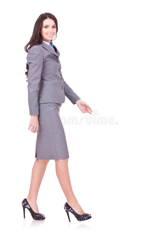 Side view of a business woman walking royalty free stock photography